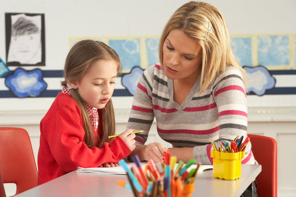 blond tutor working with young girl