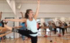 Lee at Enjoy Yoga, Pilates & Barre teaching a barre class