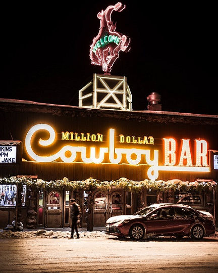 """In Wyoming, just about every town has a """"Cowboy Bar."""" Only Jackson has the only World renowned 'Million Dollar Cowboy Bar' - COWBOYS and PICKUPS – WHISKEY DRINKING COWGIRLS"""