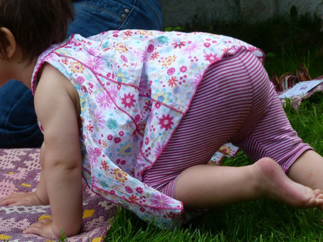 7 FUN IDEAS FOR ENCOURAGING CREEPING AND CRAWLING
