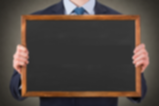 Man holding blackboard.png