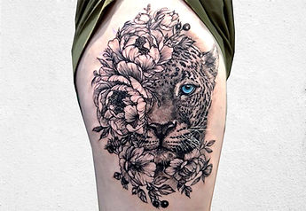 thigh tattoo.jpg