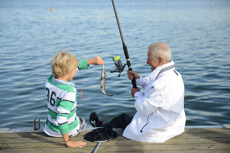 grandpa fishing with grandson