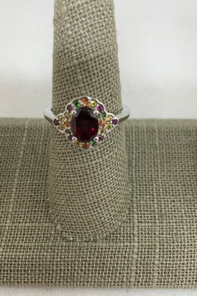 Ruby colored oval stone with multi colored stones
