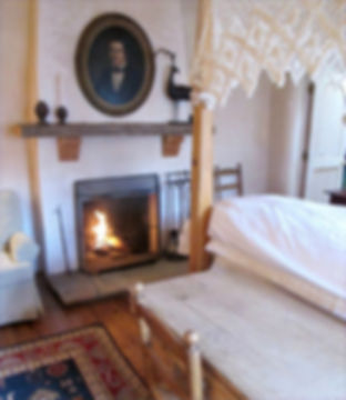Fireplace in bedroom, Shadow of the Bells vacation rental in the Historic Guadalupe Area, walking distance to Santa Fe plaza, restaurants, Santuario de Guadalupe