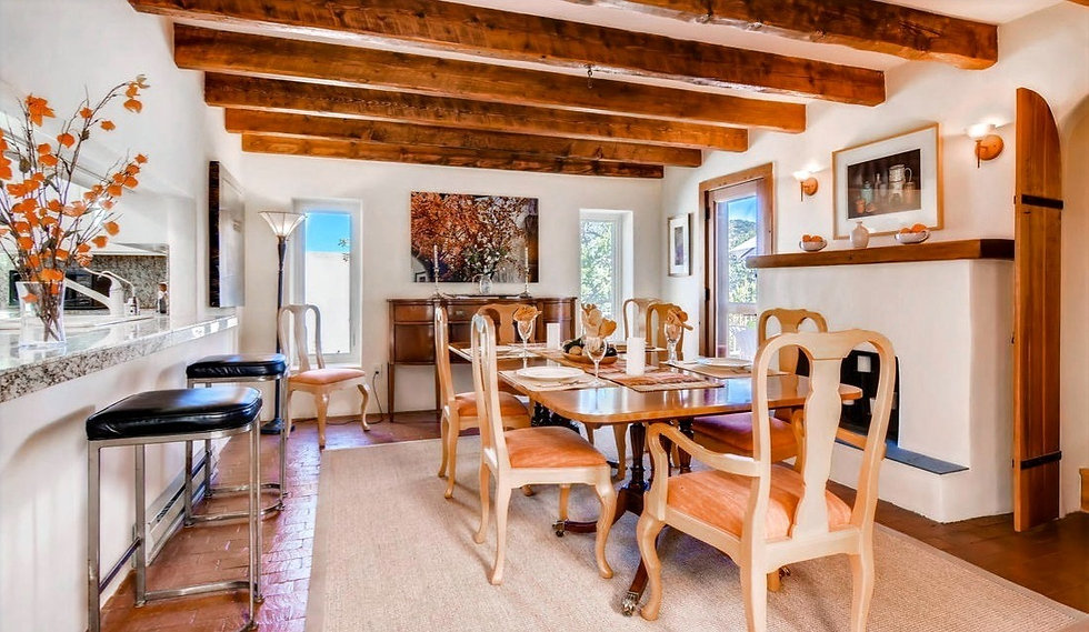 Modern harmonizes with classic Santa Fe style in this open concept kitchen/dining area with patio and mountain views