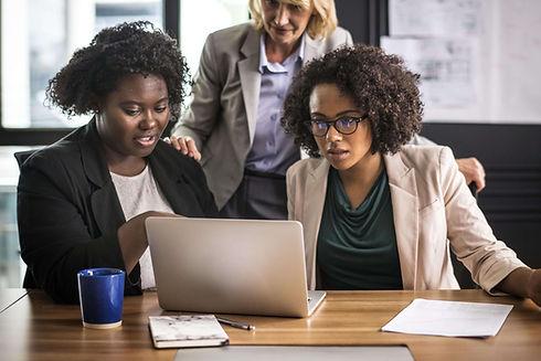 businesswomen-working-laptop-min.jpg