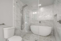 20 - master bath shower suite.jpg