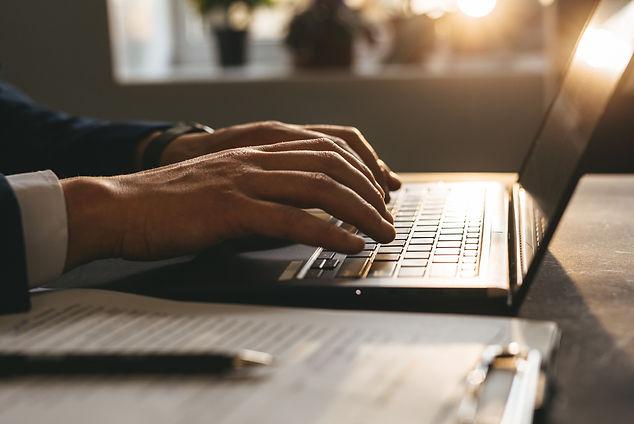 businessman-keyboard-work-laptop-online-