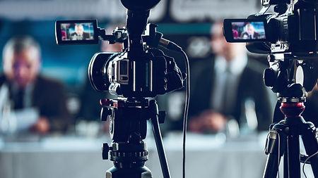 camera-recording-press-conference-SJGC9D