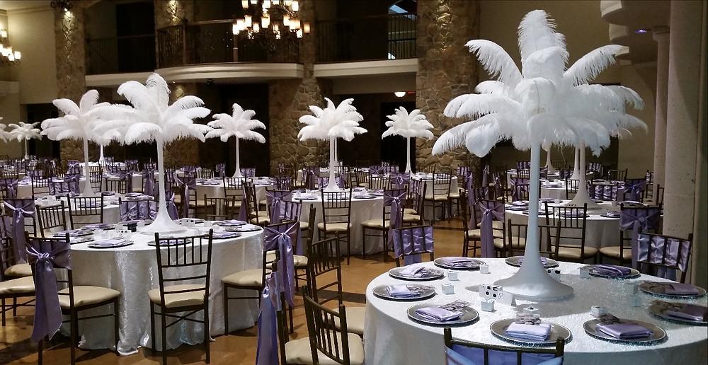 White ostrich feathers centerpieces, by DesignerCenterpieces.com