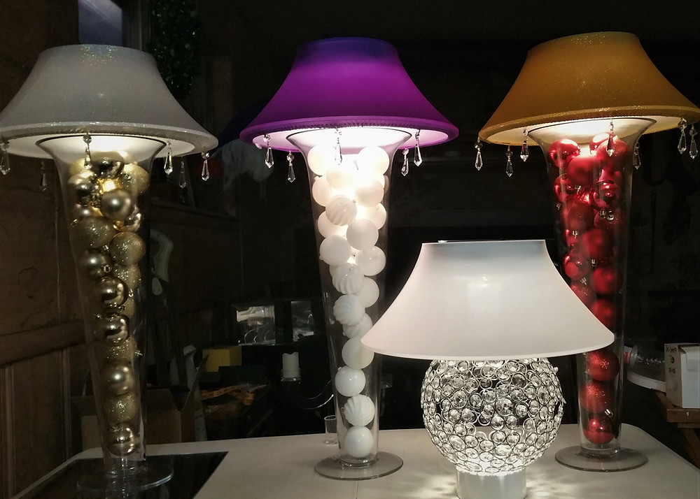 Choose your color of Spandex Lamp shades, Gold, Silver and White Deco Balls are added in the extra wide vase above