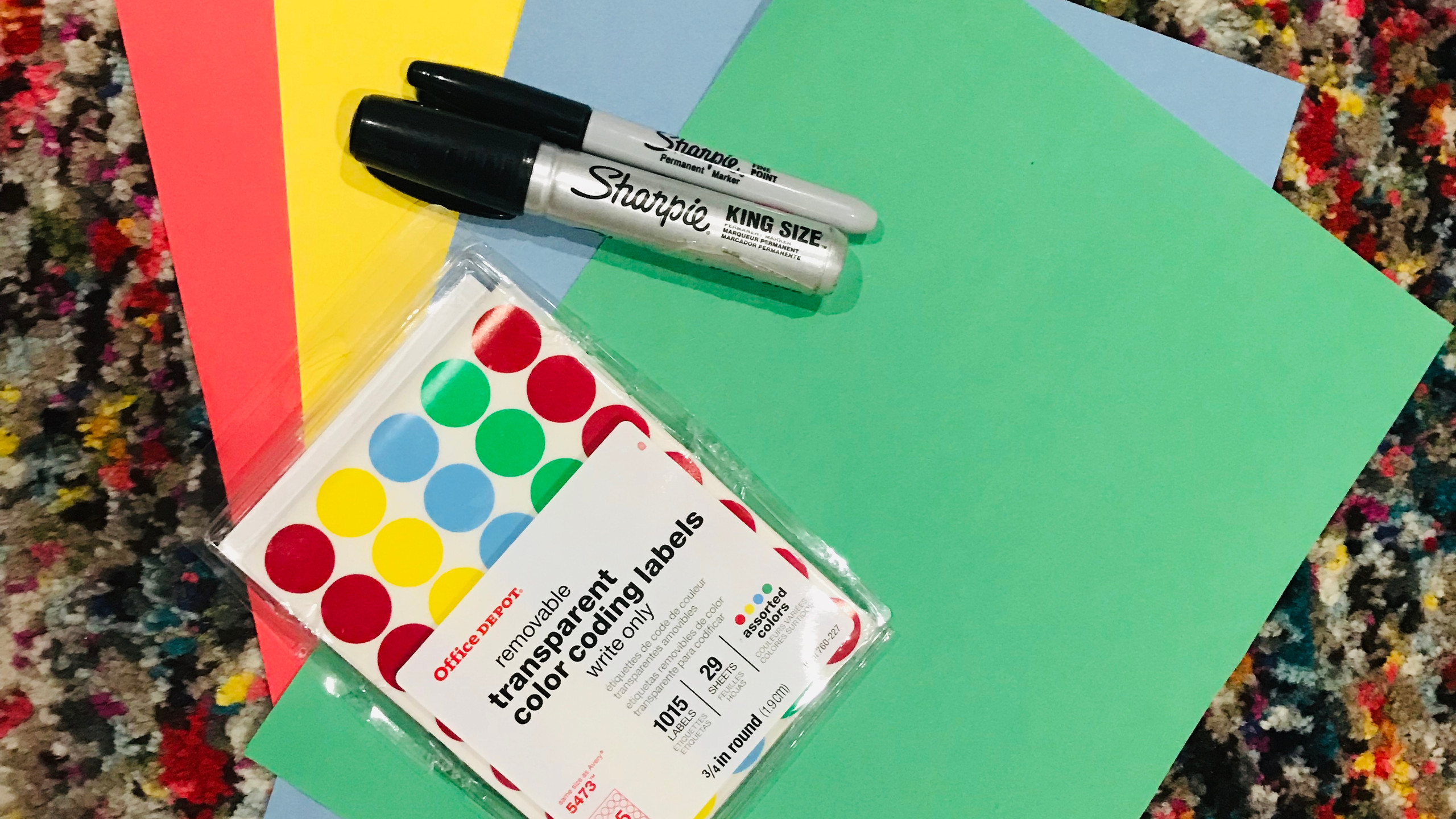 construction paper with black markers and colorful dot stickers
