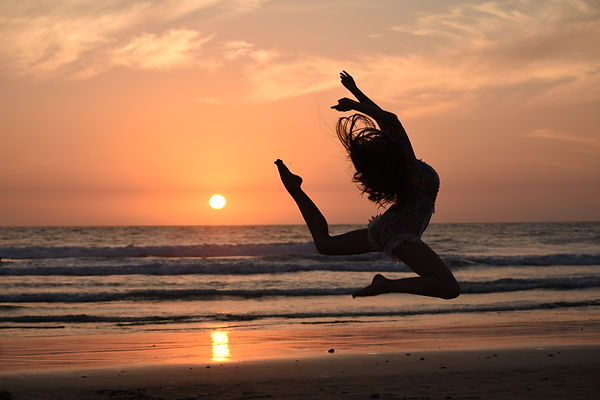 silhouette%20of%20woman%20jumping%20duri