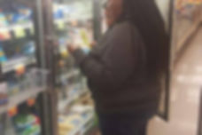 People look at frozen vegetables in grocery store