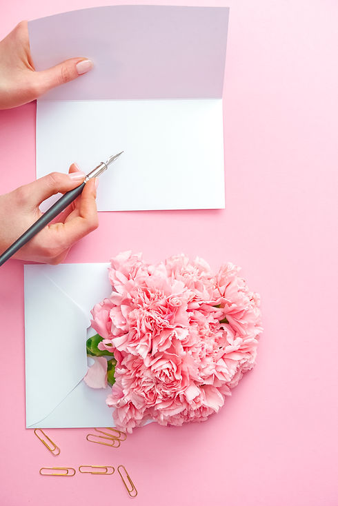 Cropped shot of woman writing on greetin