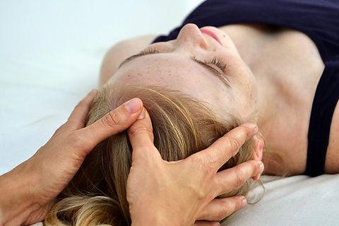 Woman receiving thai table massage