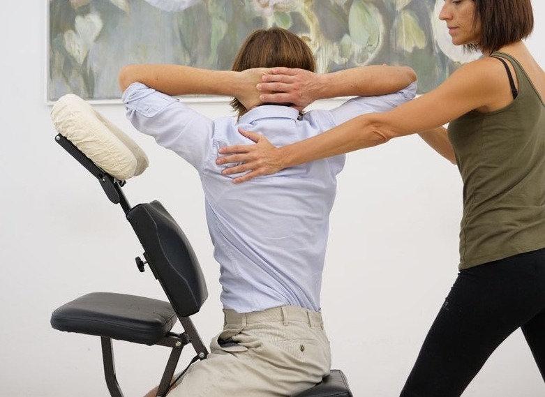 woman receiving a chair massage