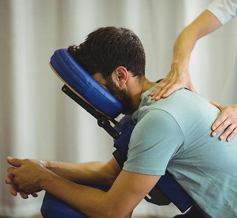 Man receiving chair massage