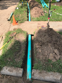 Pipe dug beneath sidewalk, restabilized