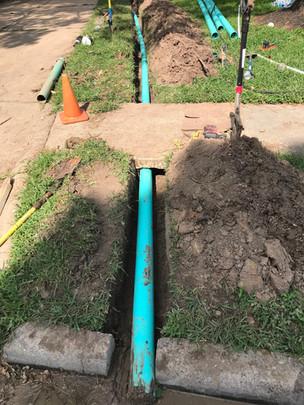 Pipe dug beneath sidewalk, restabilized