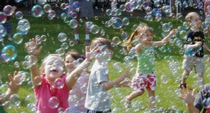 children-playing-in-bubbles-300x162.jpg