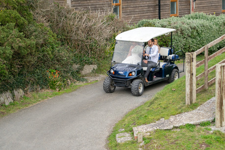 Bride being driven around in a golf buggy