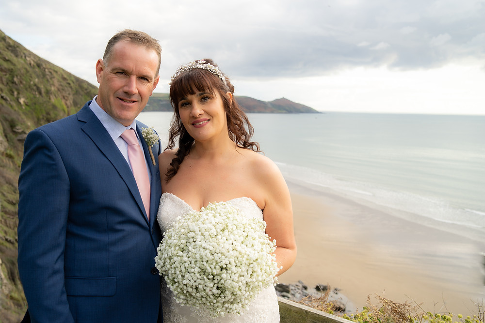 Bride & Groom posing at the top of Whitsand Bay