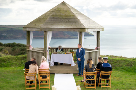 Groom and guests awaiting the arrival of the bride on a clifftop at Whitsand Bay