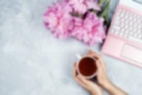 Feminine business mockup with pink lapto