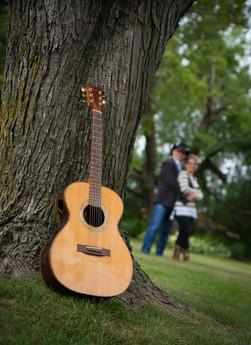 Guitar Leaning On Tree-Voom On Guiatr-Mi