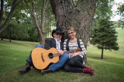 Mike-Cindy-Guitar-Sitting By Tree.jpg