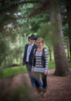Mike and Cindy Through Pine Tree.jpg