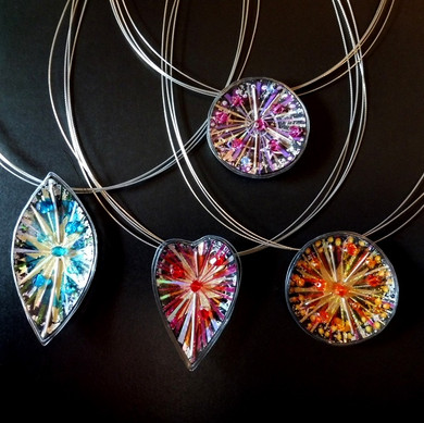 Colourful fireworks necklaces, price guide £40- £44