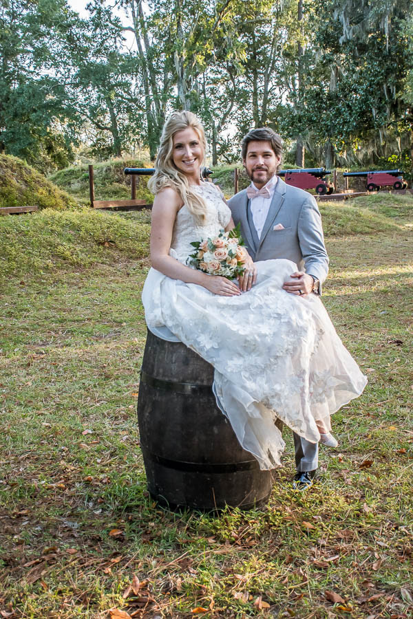 bride sitting on barrel of love