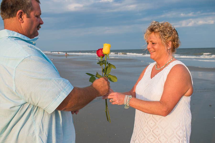 Rose exchange as part of a vow renewal ceremony