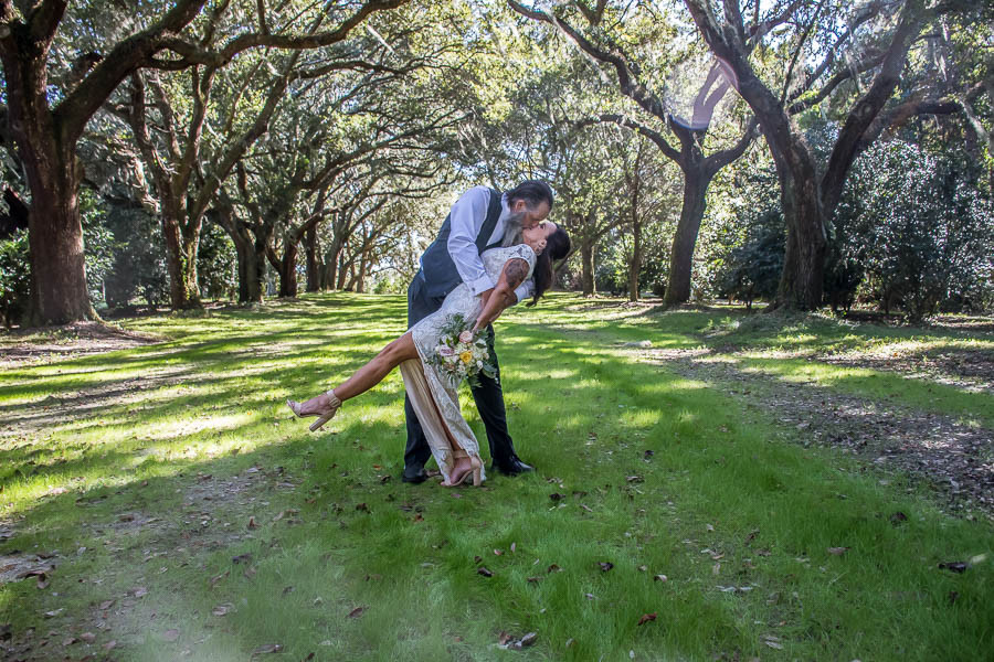 dipped kiss under the large mossy oaks