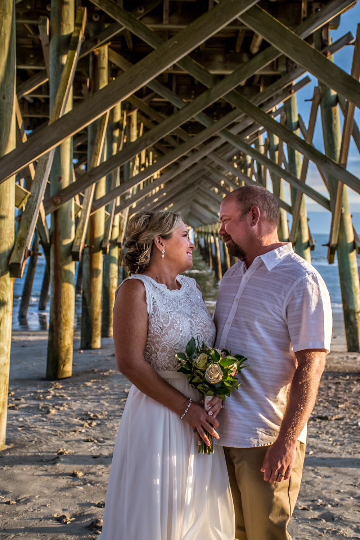 under the folly beach pier elopement