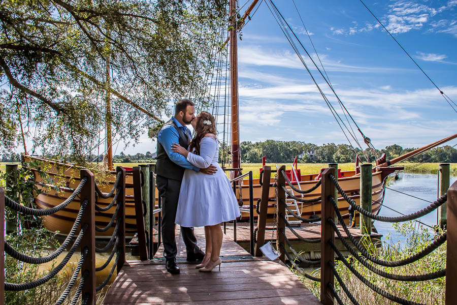 elopement photo of a couple in front of the pirate ship at charleston sc