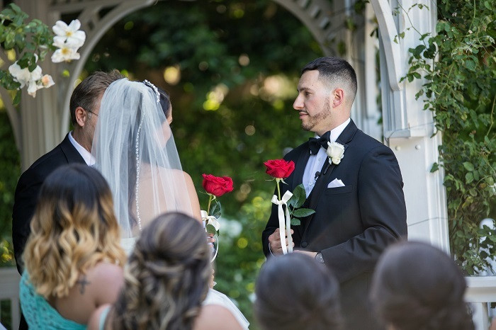 exchanging roses in a wedding ceremony to represent love
