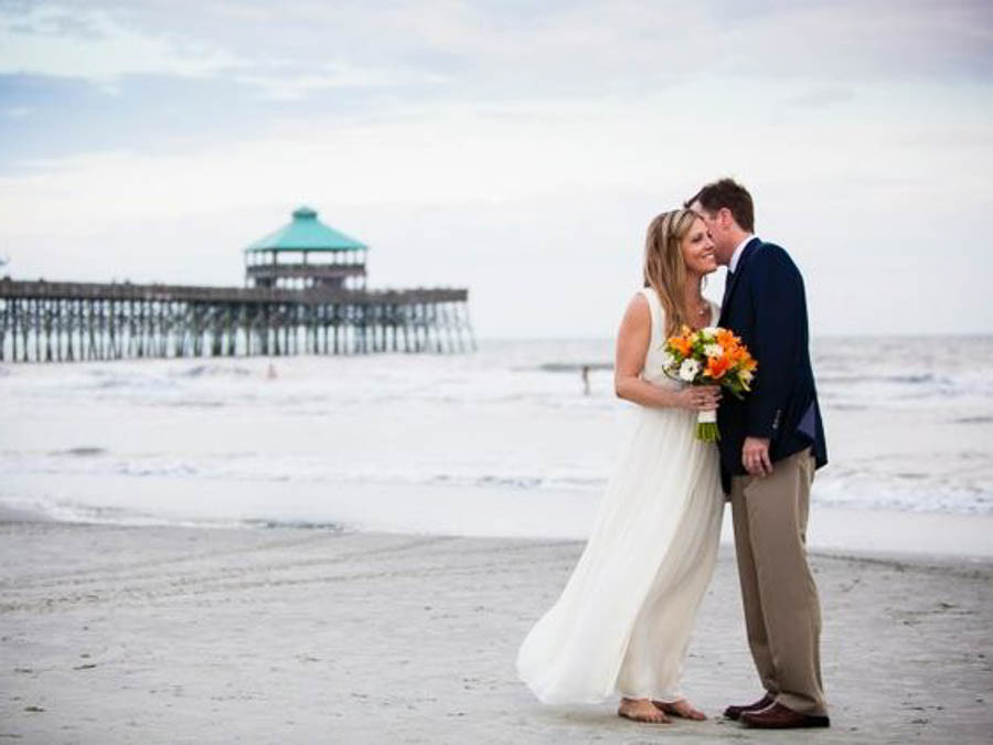 elopement on folly beach sc by the fishing pier behind tides hotel
