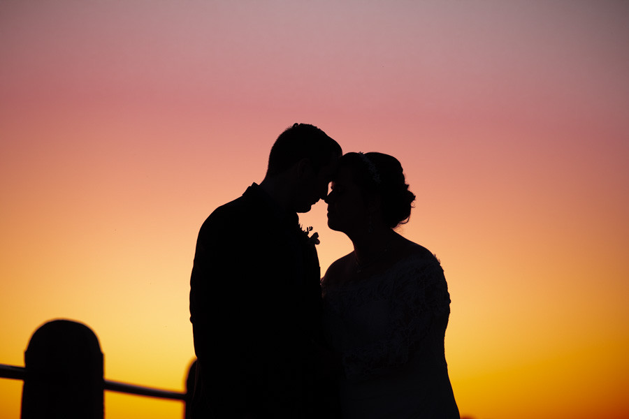 perfect sunset silhouette from charleston elopement
