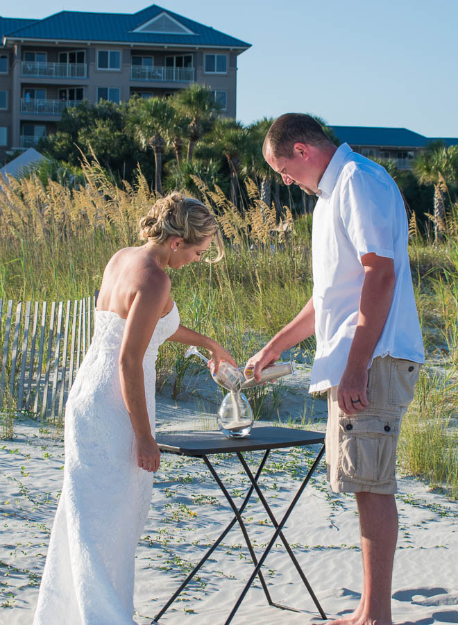 bride and groom pouring sand during wedding ceremony