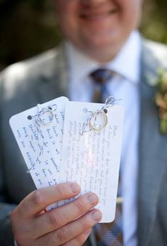 best man hold written wedding vows for bride and groom
