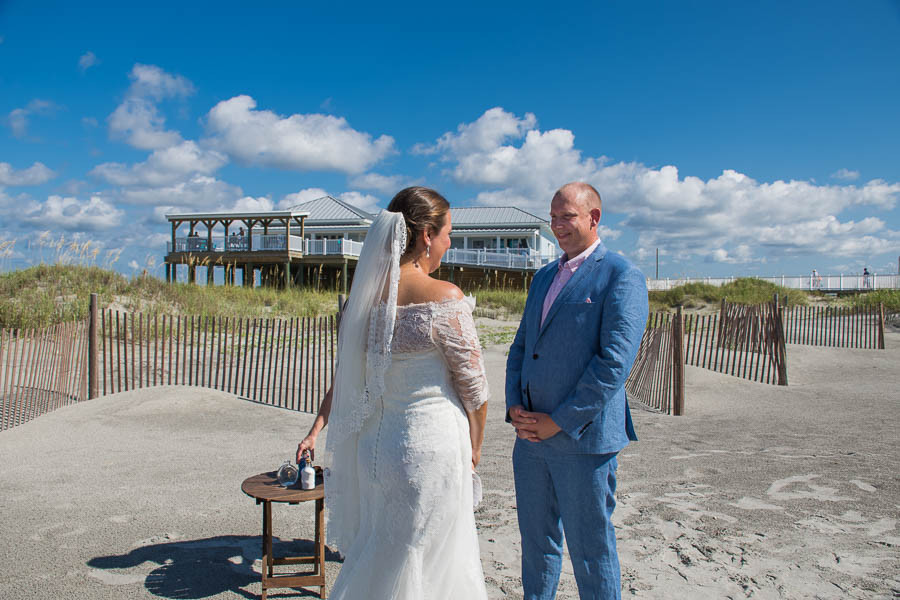beach elopement wedding ceremony by the dunes house at folly beach