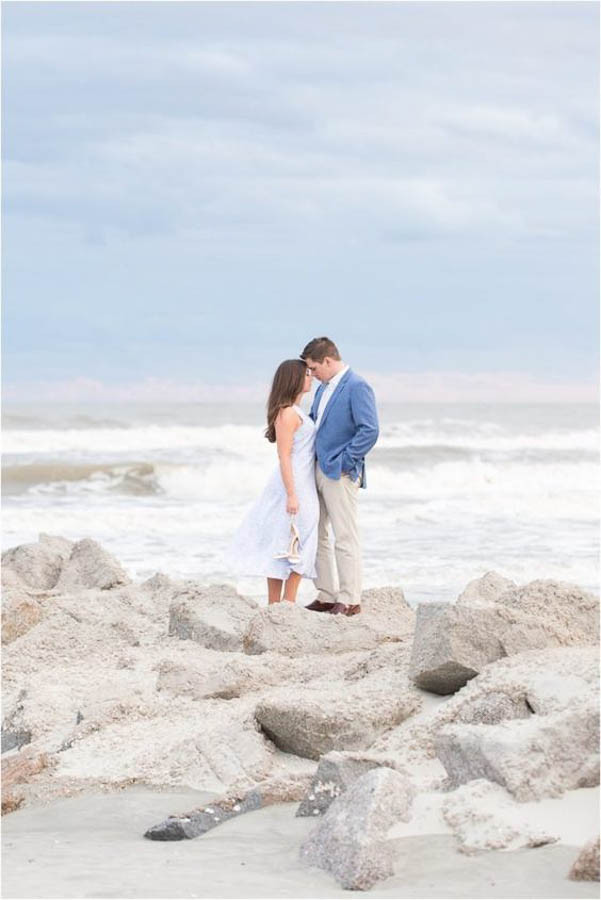 romantic elopement photo on the rocks at folly beach
