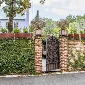 Ivy Covered Brickwall with Iron Gate