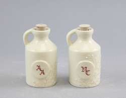Mini whiskey jugs with initials.