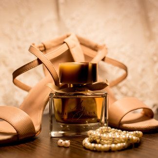 brown-glass-fragrance-bottle-beside-whit