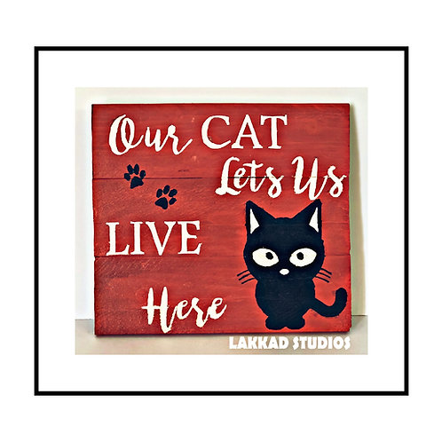 """Rustic wooden Wall Art Cat Sayings""""Our Cat lets us live here"""""""